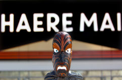 Maori sculpture under sign reads Welcome in Maori stock image