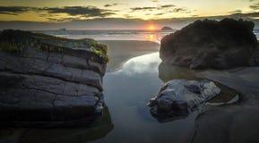 maori solnedgång för fjärd Arkivfoton