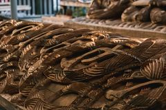 A Maori statue carving in its early stages at a carpentry in Te Puia, Rotorua, New Zealand stock images