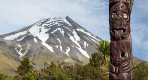 Maori statue in front of Volcano Taranaki, New Zealand Royalty Free Stock Photography