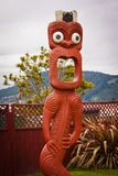 Maori statue with open mouth and big eyes in Rotorua, New Zealand. Maori statue with open mouth and big eyes in Rotorua in New Zealand, traditional crafted stock images