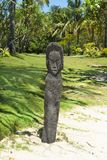 Maori statue scarved from palm tree, Fiji Stock Images