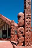 Maori tekoteko, Ohinemutu, Rotorua. WS: A Tekoteko (Maori statue) outside the Ohinemutu Wharenui (Meeting House) on the lakefront of Rotorua, New Zealand, host stock photos
