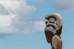 Maori totem against blue sky Stock Photography