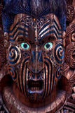 Maori Totem. Detail of a Maori warrior carved in a totem pole stock photography