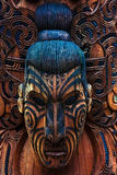 Maori Totem. Detail of a Maori warrior carved in a totem pole stock image