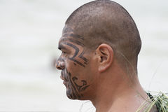 Maori warrior with paint of tattoo running on face Stock Images