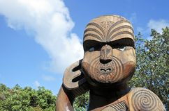 Maori warrior wood carving statue. In Karekare beach in the West Coast of the North Island near Auckland. Wood carving is a sacred art form for Maori native royalty free stock image