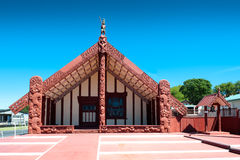 Maori Wharenui, Ohinemutu, Rotorua. WS: The Ohinemutu Wharenui (Maori Meeting House) on the lakefront of Rotorua, New Zealand, host nation of the Rugby World Cup royalty free stock photo