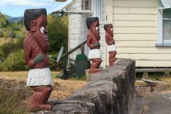 Maori wood carving. Row of warrior figurines at Whakarewarewa, New Zealand Royalty Free Stock Images