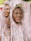 Maori Wood Sculpture. These wood sculptures represent the Maori people who are the native or indigenous Polynesian people of New Zealand. The lines on the face royalty free stock photos