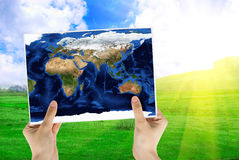 Map. Hand holding map on nature background with sunrise stock photos