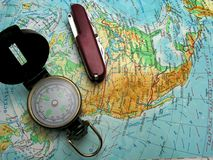 Map. Am map, swiss army knife and compass for traveling around the world Royalty Free Stock Photo