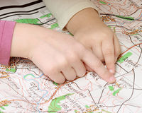 Map. On a photo children view the map Stock Image