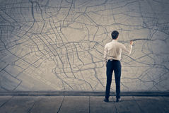 Map. Young businessman writing on the map Royalty Free Stock Photography