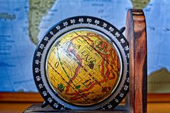 Map of Africa on an ancient globe with world map in the background stock photos