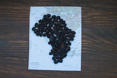 Map of Africa. And coffee beans on wooden table, top view Royalty Free Stock Image