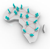 Map of Africa - Network of People. A map of Africa on white with a network of people standing atop it Stock Photos