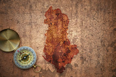 Map of albania on a old vintage crack paper. Background with compass royalty free stock image