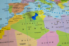 Map of Algeria with a blue pushpin stuck Stock Images