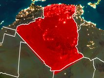 Map of Algeria at night. Algeria highlighted in red from Earth's orbit at night with visible country borders. 3D illustration. Elements of this image furnished Royalty Free Stock Photos