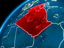 Map of Algeria at night. Algeria highlighted in red from Earth's orbit at night with visible country borders. 3D illustration. Elements of this image furnished Royalty Free Stock Image