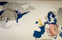Map of america and EU, bills and flags. Royalty Free Stock Photo