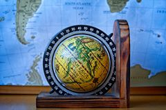 Map of Africa on an ancient globe with world map in the background stock image