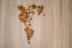 Map of the american continent made with coins.  stock photos