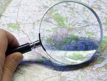 Map And Magnifying Glas Royalty Free Stock Photos