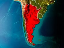 Map of Argentina on Earth. Argentina in the morning highlighted in red on planet Earth with visible border lines and city lights. 3D illustration. Elements of Royalty Free Stock Photo