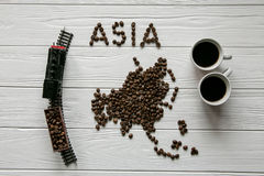Map of the Asia made of roasted coffee bean Map of the Asia made of roasted coffee bes laying on white wooden textured background. Map of the Asia made of Royalty Free Stock Photos