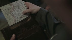 Map attack in the hands of a soldier. World war II. The reconstruction of the battle stock video