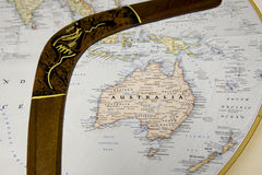 Map of Australia with wooden boomerang. Australia on world map surrounded by wooden boomerang with indigenous art Stock Photos