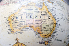 Map of Australia on a world globe. Close up of a map of Australia on a world globe showing the surrounding area royalty free stock image