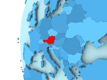 Map of Austria. 3D render of Austria in red on blue political globe. 3D illustration Stock Photos