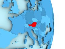 Map of Austria in red. Austria in red on simple blue political globe with visible country borders. 3D illustration Royalty Free Stock Photo