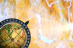 Map background. Old globe on background of map Stock Photos