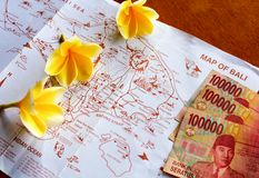 Map of Bali. Money and flowers Stock Photography