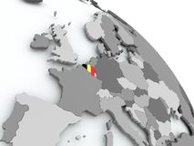 Map of Belgium with flag on globe Royalty Free Stock Images
