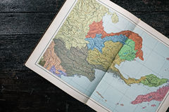 Map book on the dark wood Royalty Free Stock Image
