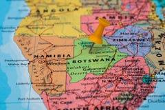 Map of Botswana with a orange pushpin stuck. Map of Botswana with a pushpin stuck Royalty Free Stock Images