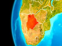 Map of Botswana in red. Botswana as seen from Earth's orbit on planet Earth highlighted in red with visible borders. 3D illustration Royalty Free Stock Image