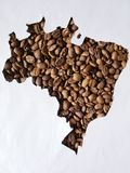 Map of Brazil with roasted coffee beans and white background. Backdrop for cafeteria and coffee products, agriculture and harvest, seeds with flavor and aroma stock photography
