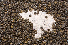 Map of Brazil under a background of coffee beans Royalty Free Stock Photos