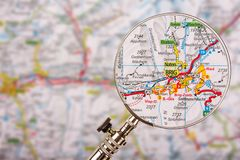 Map of Brig Naters with magnifying glass on table. Map of Brig Naters with magnifying glass and blured focus stock image