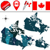 Map of Canada. Vector map of Canada with named provinces, territories and travel icons Stock Images