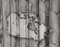 Map of Canada on weathered wood. Colorful and crisp image of map of Canada on weathered wood Stock Photography