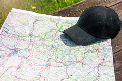 Map and cap. On wooden table Stock Photo