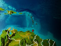 Map of Caribbean on Earth. Caribbean in the morning highlighted in red on planet Earth with visible border lines and city lights. 3D illustration. Elements of Royalty Free Stock Photography